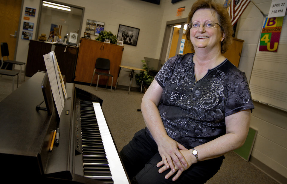 John Marshall High School vocal music teacher Denise Caton poses for a photo at her piano at John Marshall High School on Friday, March 30, 2012, in Oklahoma City, Okla. Photo by Chris Landsberger, The Oklahoman