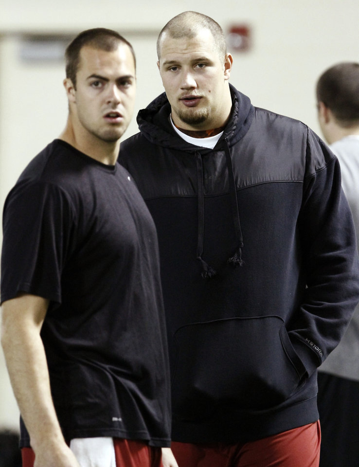 Quarterback Landry Jones, left, and offensive lineman Lane Johnson, right, talk before Oklahoma's NFL football pro day, Wednesday, March 13, 2013, in Norman, Okla. (AP Photo/Alonzo Adams) ORG XMIT: OKAA108