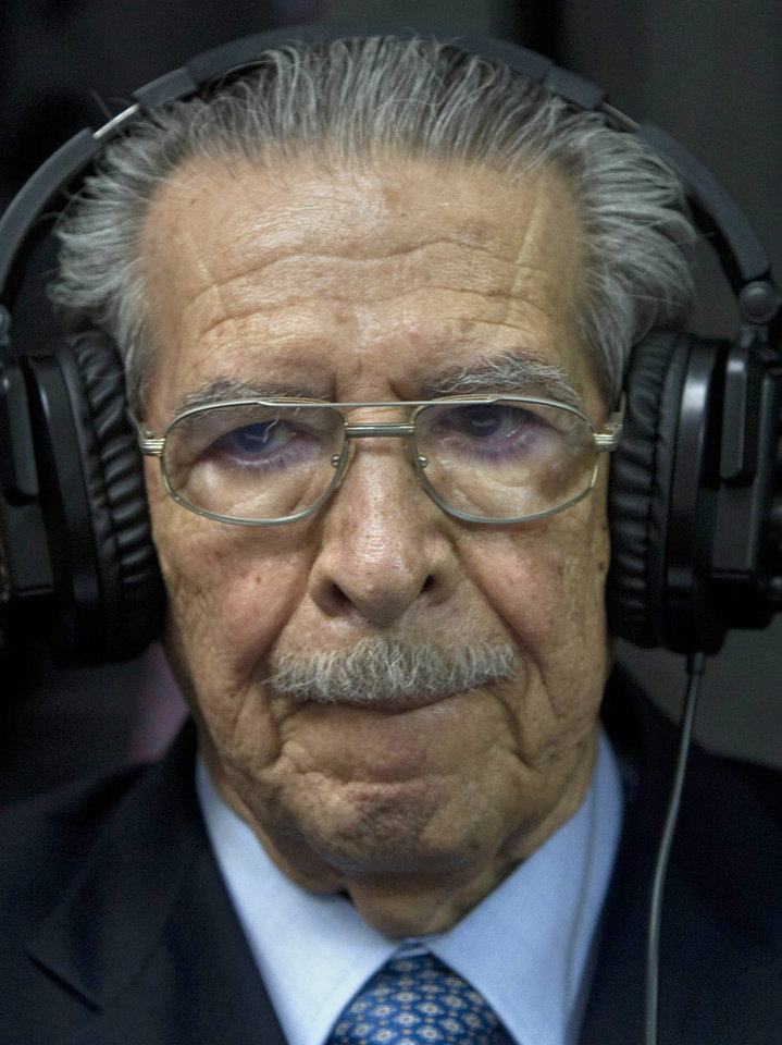 Photo - FILE - In this Friday, May 10, 2013 file photo, Guatemala's former dictator Jose Efrain Rios Montt wears headphones as he listens to the verdict in his genocide trial in Guatemala City. Guatemala's top court has overturned the genocide conviction of former dictator Efrain Rios Montt's and ordered his trial to resume. Constitutional Court secretary Martin Guzman says the trial needs to go back to where it stood on April 19 to solve several appeal issues. Monday's ruling comes 10 days after a three-judge panel convicted the 86-year-old Rios Montt of genocide and crimes against humanity for his role in massacres of Mayas during Guatemala's civil war.. (AP Photo/Moises Castillo, File)