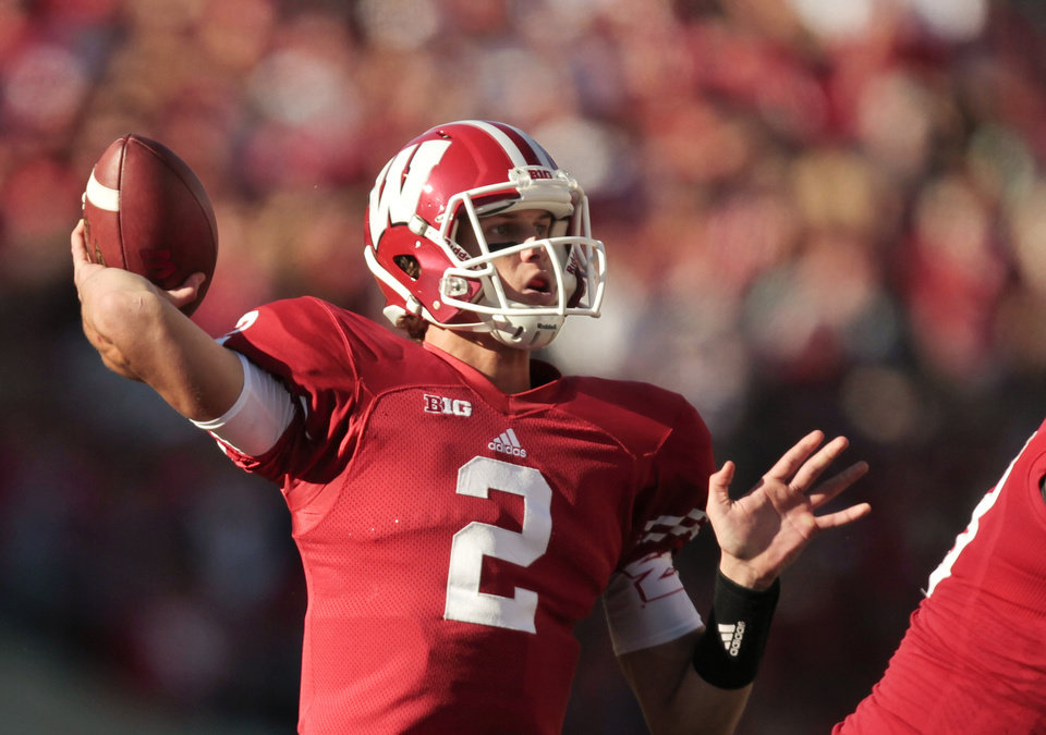 Photo - FILE - In this OCT. 13, 2013, file photo, Wisconsin quarterback Joel Stave throws against Northwestern during the first half of an NCAA college football game in Madison, Wis. The Badgers appear to have settled on dual-threat junior Tanner McEvoy as the starter, though coach Gary Andersen will not officially name one. Andersen has said both McEvoy and last year's starter, Stave, will be ready no matter what. (AP Photo/Andy Manis, File)