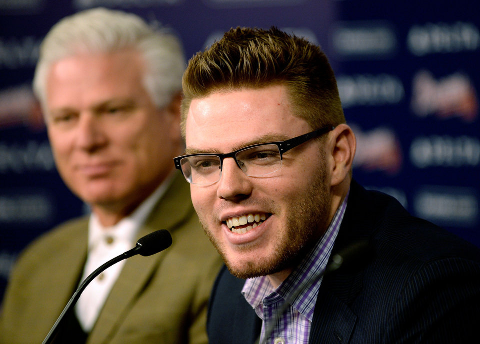 Photo - Atlanta Braves first baseman Freddie Freeman sits next to manager Frank Wren while discussing his new deal with the baseball team, Wednesday, Feb. 5, 2014, in Atlanta. Freeman said Wednesday his $135 million, eight-year deal shows he should simply continue on his current path to becoming one of the best first basemen. (AP Photo/Atlanta Journal-Constitution, David Tulis) GWINNETT OUT  MARIETTA OUT  LOCAL TV OUT (WXIA, WGCL, FOX 5)