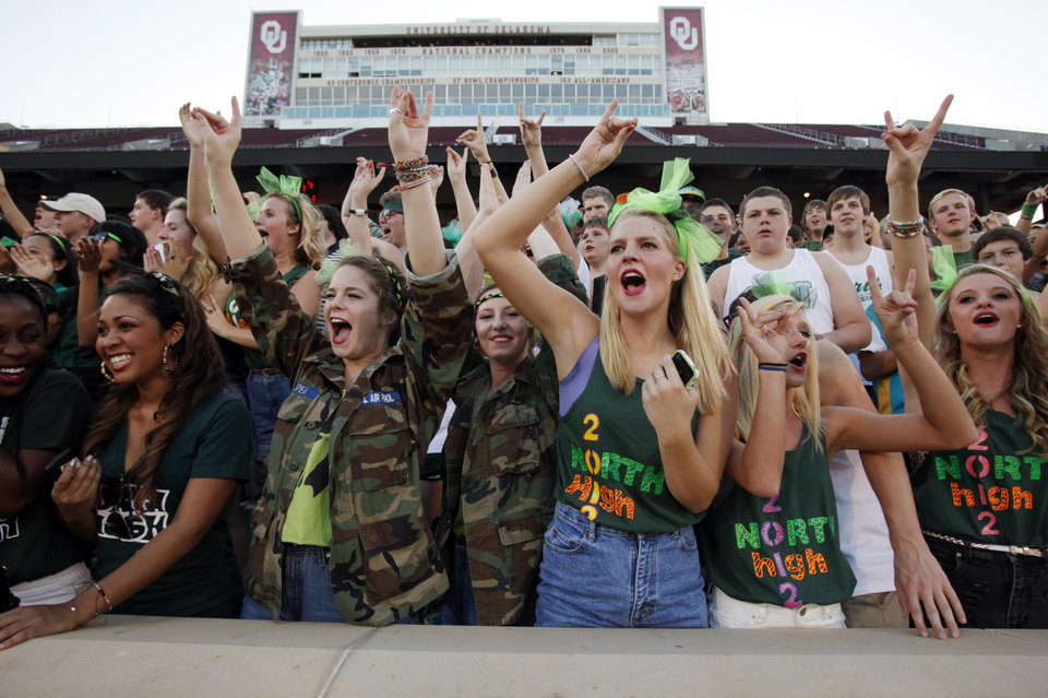 Photo - Timberwolf fans cheer as the Norman High School Tiger football team plays Norman North Timberwolves at Gaylord Family/Oklahoma Memorial Stadium on Thursday, Aug. 30, 2012 in Norman, Okla.  Photo by Steve Sisney, The Oklahoman
