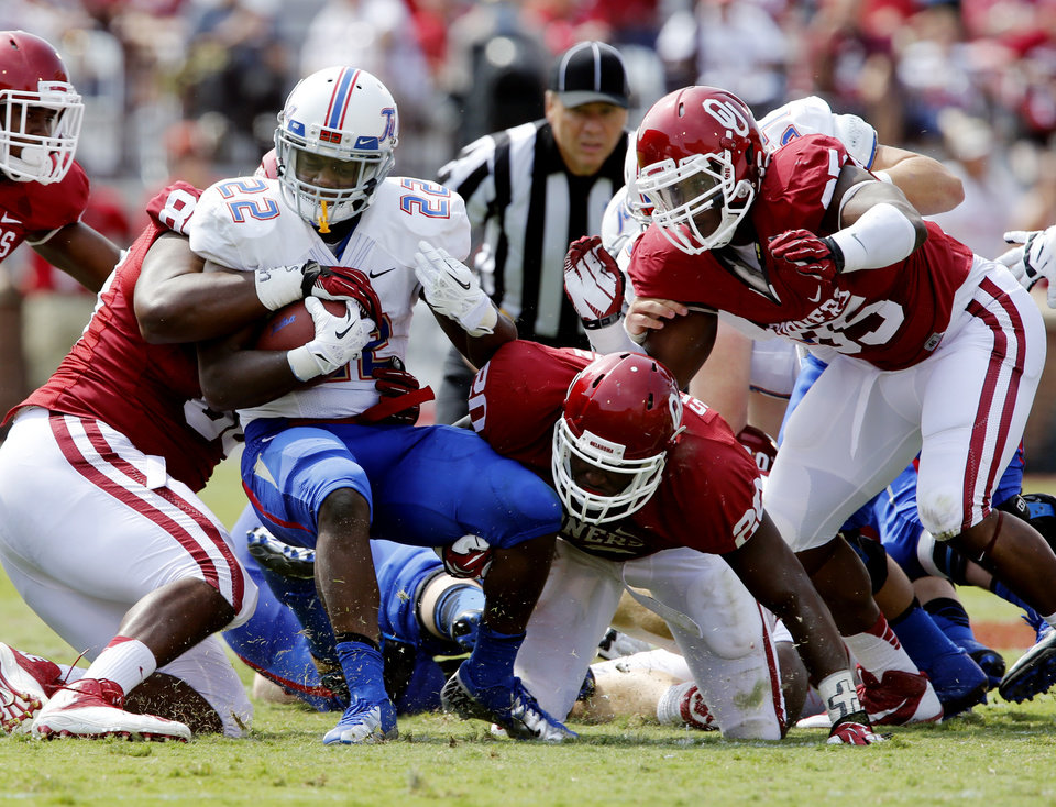 Tulsa's Trey Watts (22) is brought down after a run during a college football game between the University of Oklahoma Sooners (OU) and the Tulsa Golden Hurricane (TU) at Gaylord Family-Oklahoma Memorial Stadium in Norman, Okla., on Saturday, Sept. 14, 2013. Photo by Steve Sisney, The Oklahoman