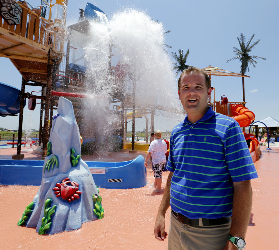 Kyle Allison, one of the owners, stands in front of a water bucket dump as people enjoy Andy Alligator\'s Fun Park on Thursday. The park recently won an award from the Oklahoma Tourism Department. Photo by Steve Sisney, The Oklahoman STEVE SISNEY - THE OKLAHOMAN