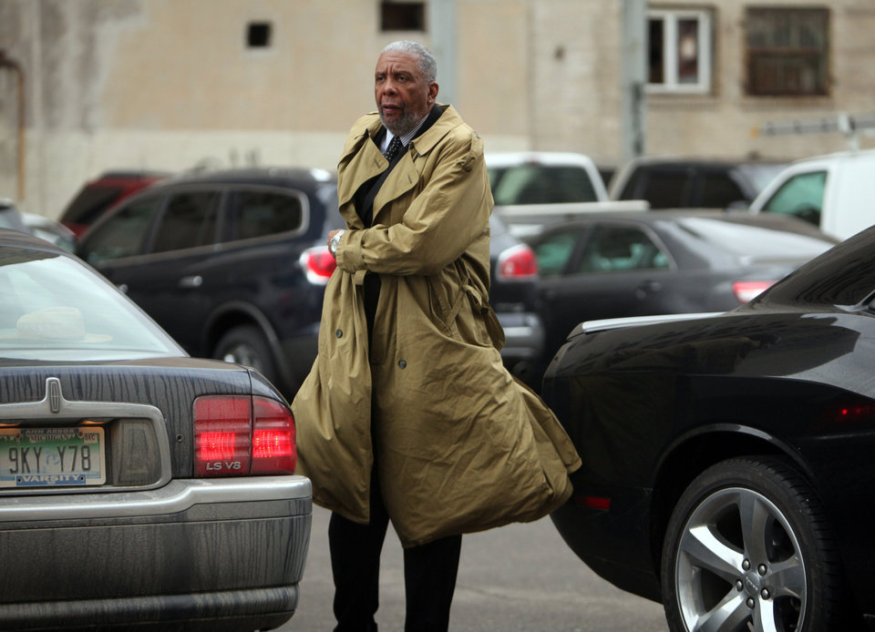 Bernard Kilpatrick makes his way in to federal court in Detroit on Monday, March 11, 2013. Former Detroit Mayor Kwame Kilpatrick was convicted Monday of corruption charges, ensuring a return to prison for a man once among the nation's youngest big-city leaders.  (AP Photo/Detroit Free Press, Regina H. Boone)