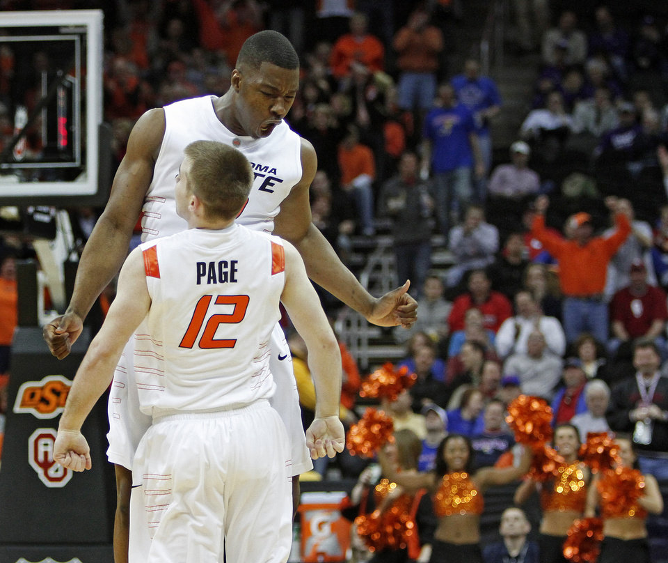 Photo - OSU's Obi Muonelo and Keiton Page celebrate in the first half of the college basketball game during the men's Big 12 Championship tournament at the Sprint Center on Wednesday, March 10, 2010, in Kansas City, Mo. Photo by Bryan Terry, The Oklahoman
