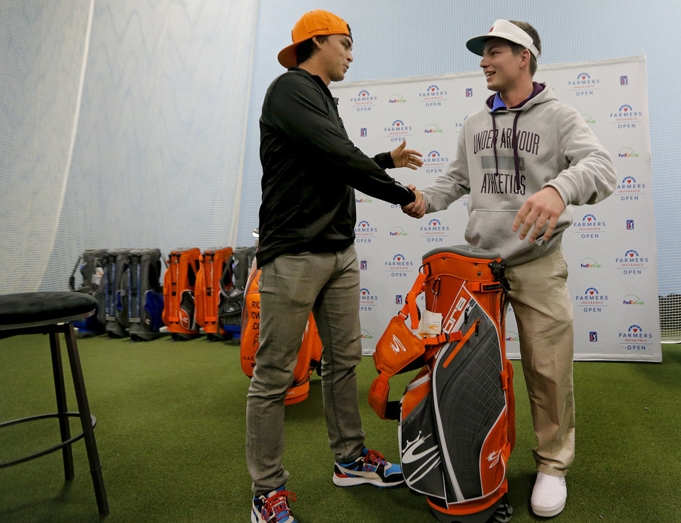 Former Oklahoma State golfer and current PGA pro Rick Fowler shakes hands with Moore tornado survivor Jake Rddington while Fowler makes a special appearance at Golfsmith in Oklahoma City, Okla. as a surprise to members for the three Moore school\'s golf teams, Monday, Jan. 6, 2014. .Photo by Chris Landsberger, The Oklahoman
