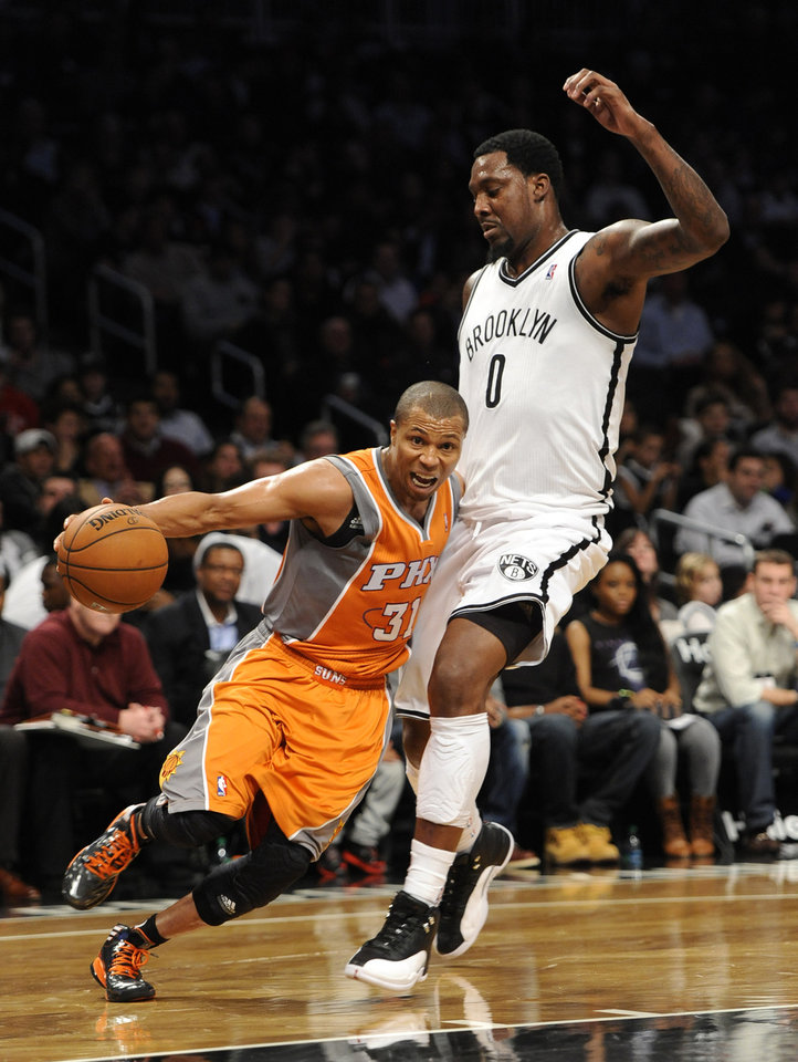 Phoenix Suns' Sebastian Telfair (31) tries drive the ball around Brooklyn Nets' Andray Blatche (0) in the second half of an NBA basketball game on Friday, Jan., 11, 2013 at Barclays Center in New York. The Nets won 99-79. (AP Photo/Kathy Kmonicek)