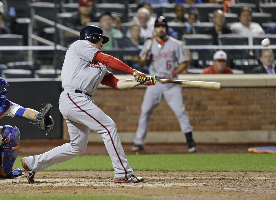 Photo - Washington Nationals' Asdrubal Cabrera hits a home run during the eighth inning of a baseball game against the New York Mets Wednesday, Aug. 13, 2014, in New York.  (AP Photo/Frank Franklin II)
