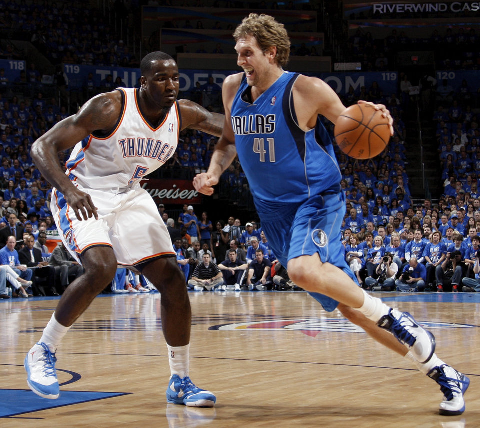 Dallas\' Dirk Nowitzki (41) drives against Oklahoma City\'s Kendrick Perkins (5) during game one of the first round in the NBA playoffs between the Oklahoma City Thunder and the Dallas Mavericks at Chesapeake Energy Arena in Oklahoma City, Saturday, April 28, 2012. Photo by Nate Billings, The Oklahoman