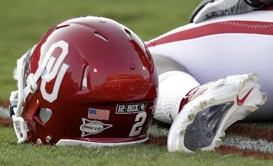 Photo - A sticker to remember Oklahoma's Austin Box is seen on the back of Trey Franks' helmet during the college football game between the University of Oklahoma Sooners ( OU) and the Tulsa University Hurricanes (TU) at the Gaylord Family-Memorial Stadium on Saturday, Sept. 3, 2011, in Norman, Okla. Photo by Chris Landsberger, The Oklahoman ORG XMIT: KOD