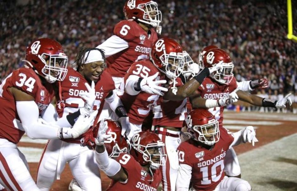 Photo -  Oklahoma's Brendan Radley-Hiles (44) celebrates his interception with teammates late in the fourth quarter of a 28-24 win against TCU on Saturday in Norman. [Sarah Phipps/The Oklahoman]