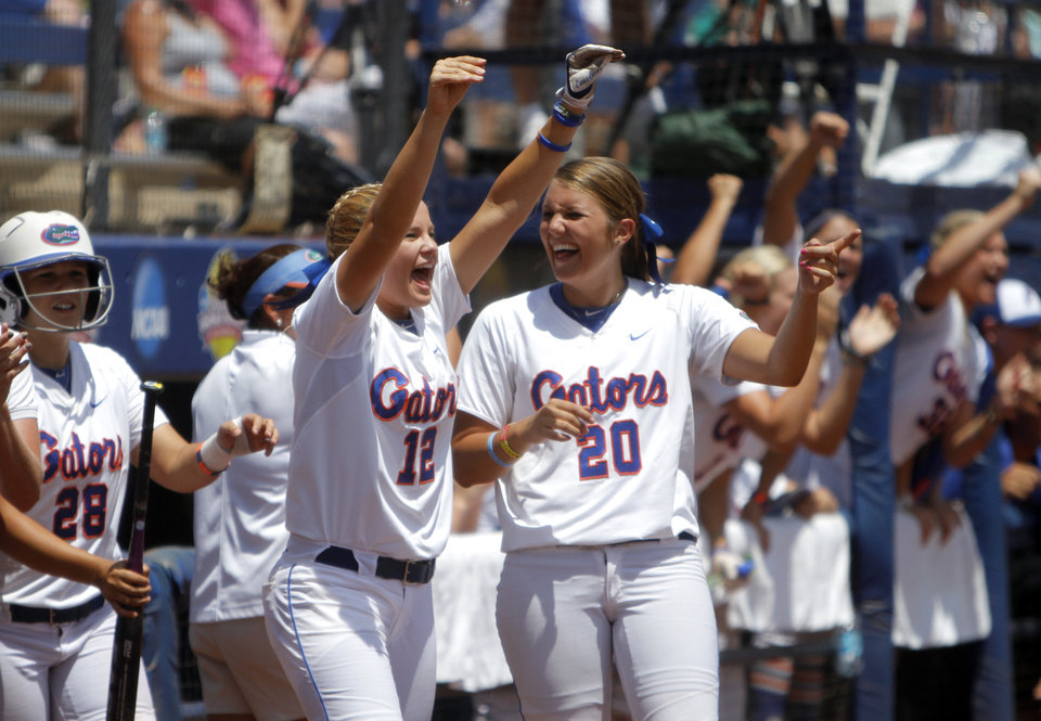 Photo - Florida celebrates a home run during the Women's College World Series game between Florida and Alabama at the ASA Hall of Fame Stadium in Oklahoma City, Sunday, June 5, 2011. Photo by Sarah Phipps, The Oklahoman