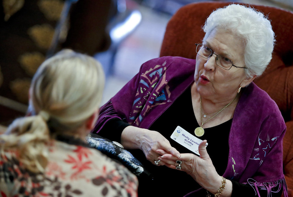 Author Molly Levite  Griffis speaks with a fan during the Norman kickoff for this year�s Big Read event.