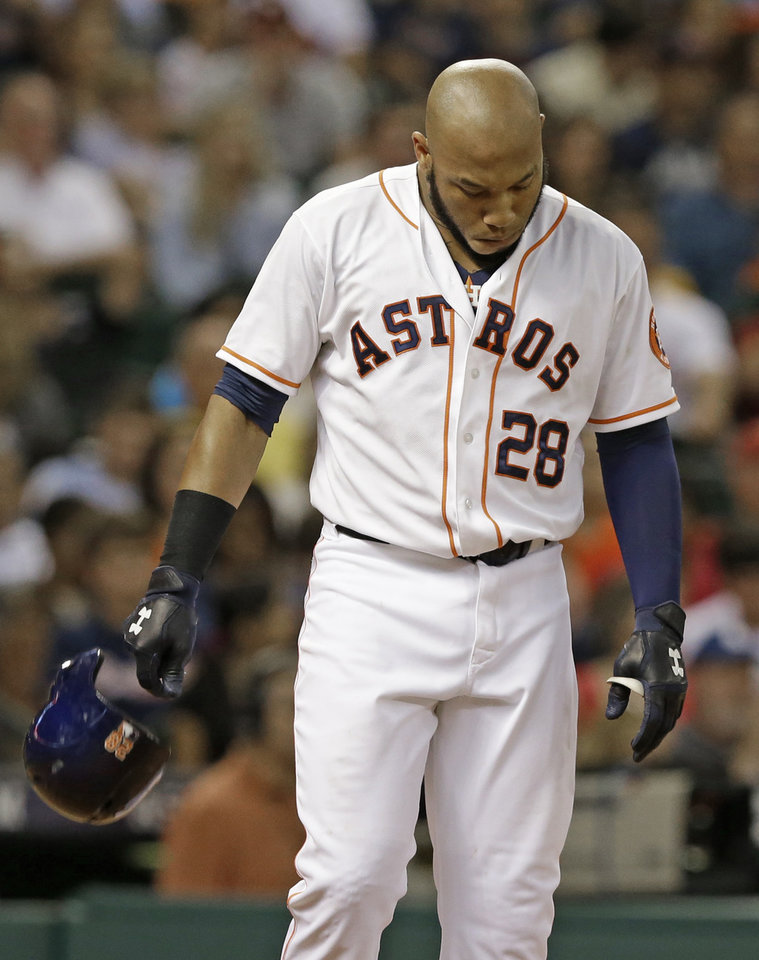 Photo - Houston Astros' Jon Singleton drops his helmet after striking out to end the sixth inning and stranding two base runners in the sixth inning of a baseball game against the Atlanta Braves, Wednesday, June 25, 2014, in Houston. (AP Photo/Pat Sullivan)