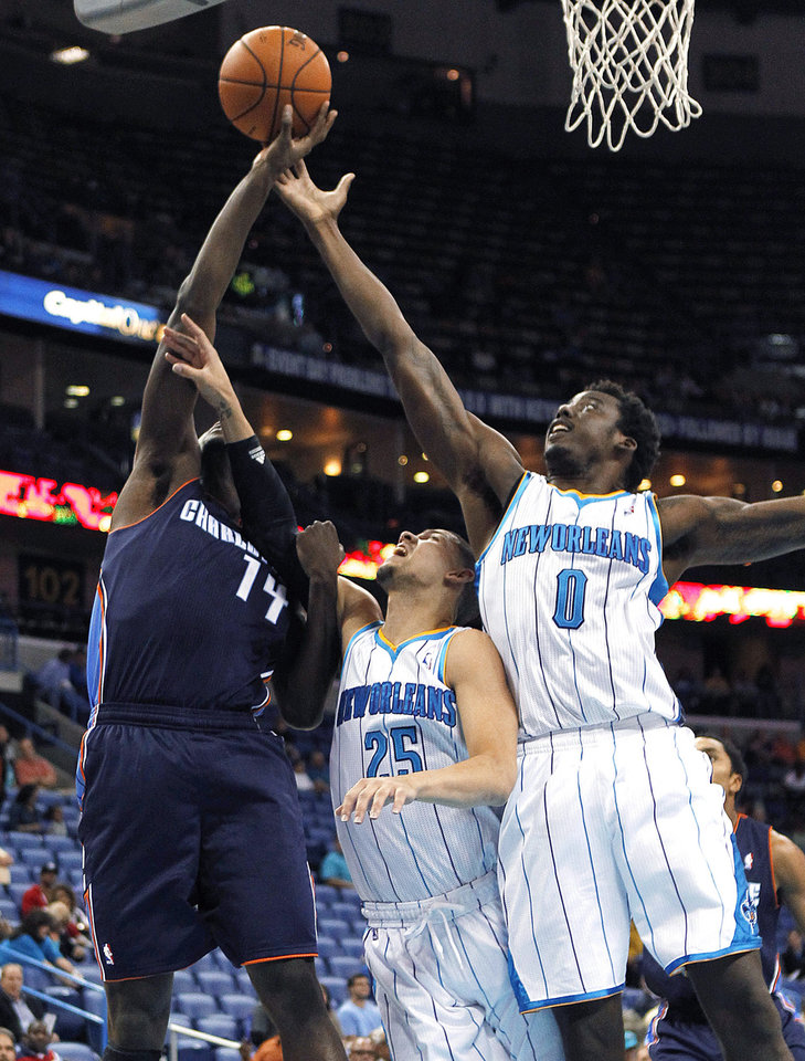 Charlotte Bobcats forward Michael Kidd-Gilchrist (14) drives to the basket against New Orleans Hornets forward Al-Farouq Aminu (0) and guard Austin Rivers (25) during the first half of an NBA preseason basketball game in New Orleans, Tuesday, Oct. 9, 2012. (AP Photo/Gerald Herbert)