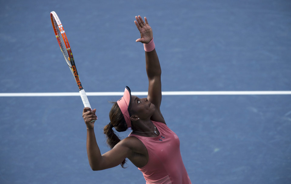 Photo - Sloane Stephens of the United States serves to Jelena Jankovic of Serbia at the Rogers Cup tennis tournament Wednesday Aug. 6, 2014 in Montreal. (AP Photo/The Canadian Press, Paul Chiasson)