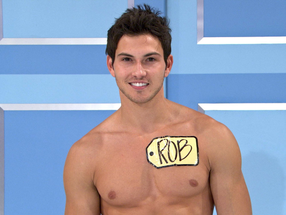 This undated image from video shows Rob Wilson, of Boston, who was chosen in an online competition to be the first male model on the popular daytime game show,