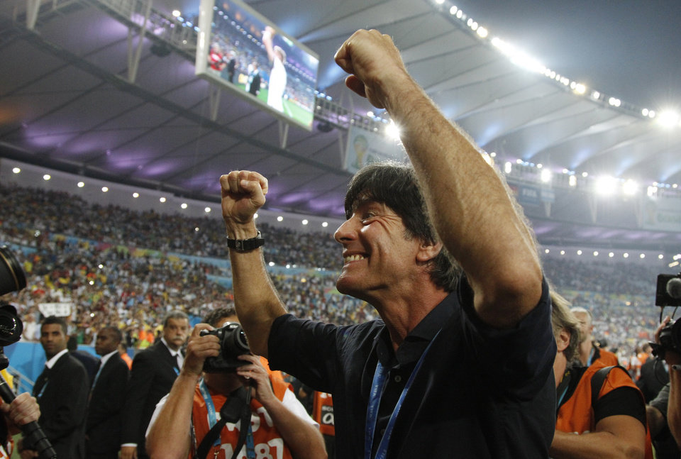 Photo - Germany's head coach Joachim Loew celebrates during a victory lap after the World Cup final soccer match between Germany and Argentina at the Maracana Stadium in Rio de Janeiro, Brazil, Sunday, July 13, 2014. Germany won the match 1-0.   (AP Photo/Matthias Schrader)