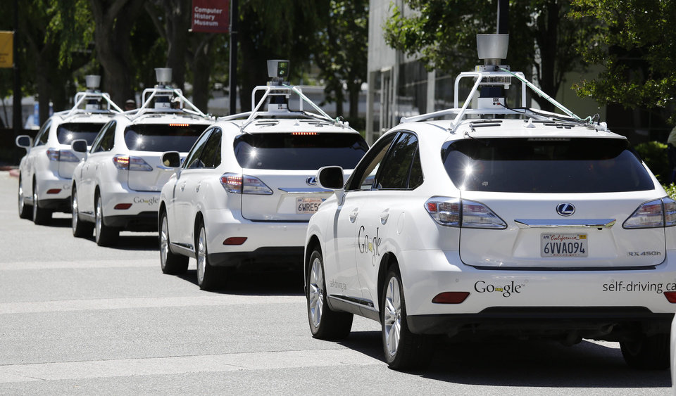 Photo - In this photo taken Wednesday, May 14, 2014, a row of Google self-driving cars are shown outside the Computer History Museum in Mountain View, Calif. Four years ago, the Google team developing cars which can drive themselves became convinced that, sooner than later, the technology would be ready for the masses. There was just one problem: Driverless cars almost certainly were illegal.(AP Photo/Eric Risberg)