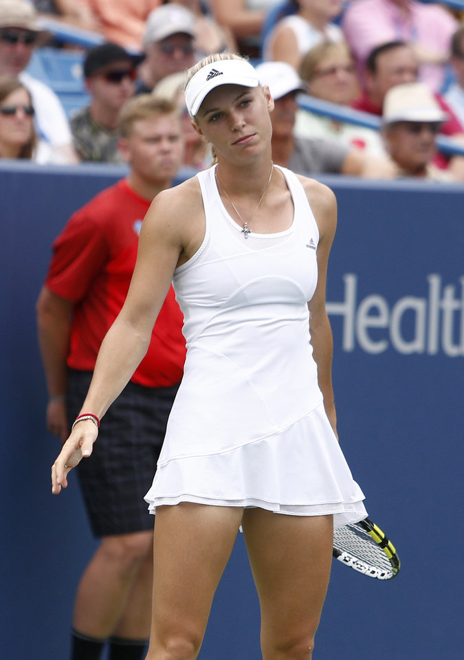 Photo - Caroline Wozniacki, from Denmark, reacts during here 2-6, 6-2, 6-4 loss to Serena Williams in the semifinals of the Western & Southern Open tennis tournament, Saturday, Aug. 16, 2014, in Mason, Ohio.  (AP Photo/David Kohl)