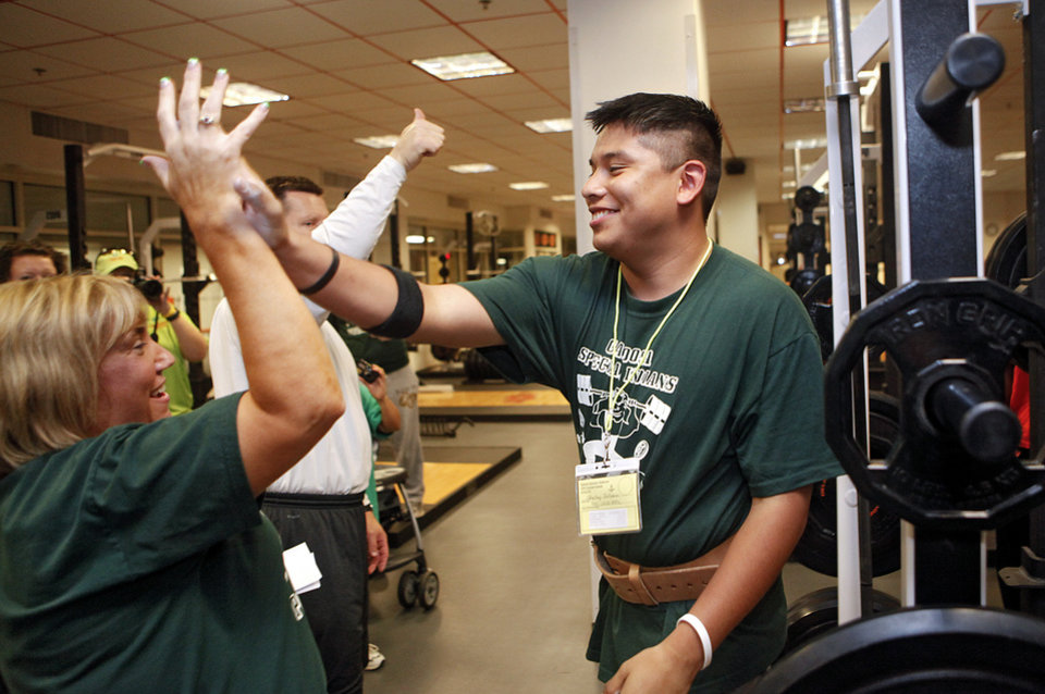 Edmond Joshua gives out high fives after completing his squat during the powerlifting competition for the Special Olympics at Oklahoma State University (OSU) on Wednesday, May 13, 2009, in Stillwater, Okla.   Photo by Chris Landsberger, The Oklahoman