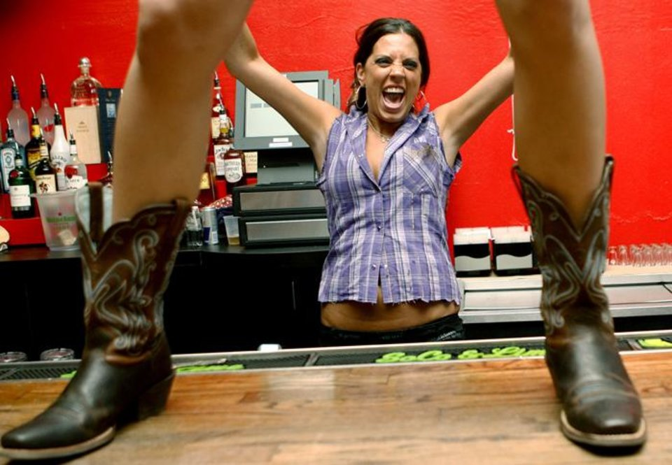 Photo -  COYOTE UGLY SALOON / BAR: Maria Hurdle, a Coyote girl, gets excited while serving drinks during the opening of Coyote Ugly in Oklahoma City Wednesday, June 24, 2009.  Photo by Ashley McKee, The Oklahoman   ORG XMIT: KOD