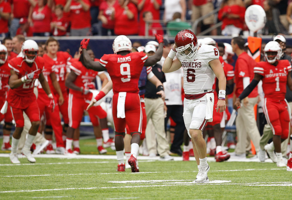 Photo - Oklahoma's Baker Mayfield (6) walks towards the bench after an Oklahoma turn over on downs in the fourth quarter of the AdvoCare Texas Kickoff college football game between the University of Oklahoma Sooners (OU) and the Houston Cougars at NRG Stadium in Houston, Saturday, Sept. 3, 2016. Houston won 33-23. Photo by Bryan Terry, The Oklahoman