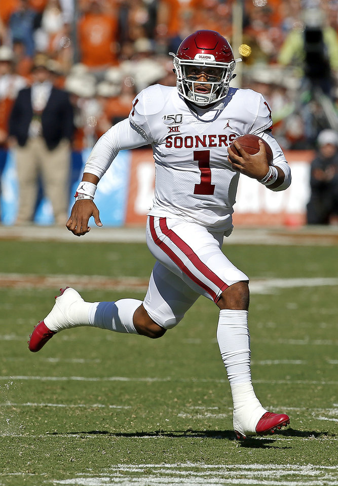 Photo - Oklahoma's Jalen Hurts (1) rushes in the first quarter during the Red River Showdown college football game between the University of Oklahoma Sooners (OU) and the Texas Longhorns (UT) at Cotton Bowl Stadium in Dallas, Saturday, Oct. 12, 2019. OU won 34-27. [Sarah Phipps/The Oklahoman]