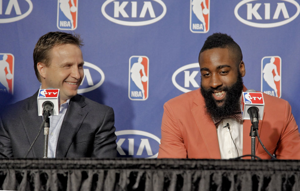 Photo - Coach Scott Brooks and James Harden laugh as they speak during the presentation of the 2012 NBA Sixth Man of the Year Award to the Oklahoma City Thunder's James Harden on Thursday,  May 10, 2012, in Oklahoma City, Oklahoma. Photo by Chris Landsberger, The Oklahoman