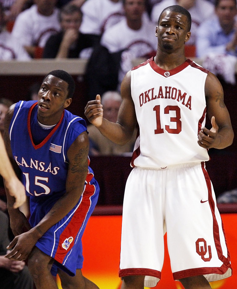 Photo - OU's Willie Warren (13) reacts after being called for a foul next to Tyshawn Taylor (15) of KU in the first half of the men's college basketball game between Kansas and Oklahoma at the Lloyd Noble Center in Norman, Okla., Monday, February 23, 2009. BY NATE BILLINGS, THE OKLAHOMAN