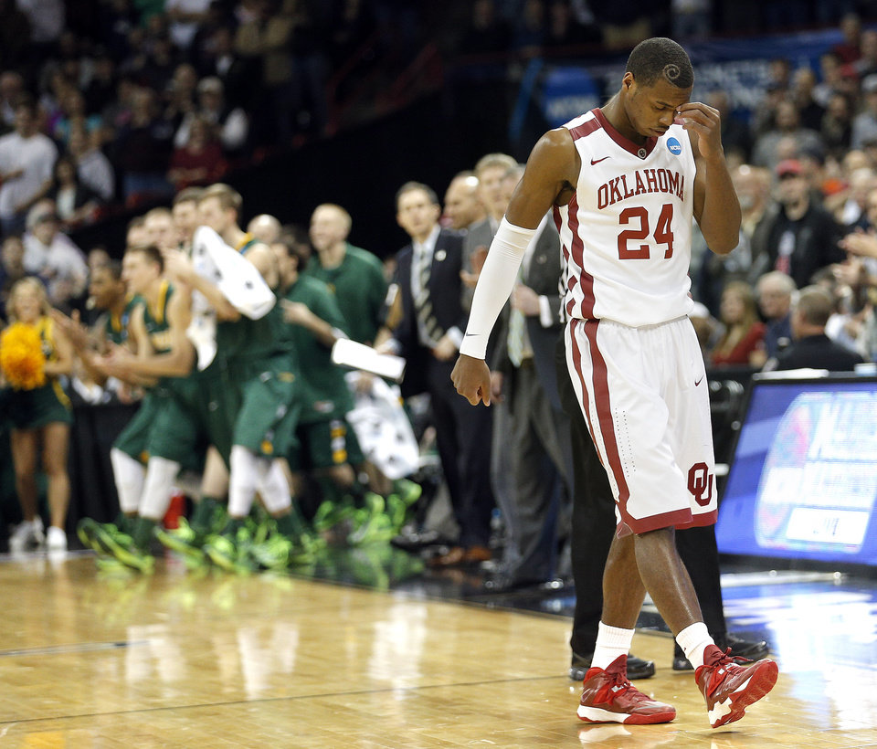 Photo - Oklahoma's Buddy Hield (24) reacts in the final seconds of the overtime during the NCAA men's basketball tournament game between the University of Oklahoma and North Dakota State at the Spokane Arena in Spokane, Wash., Thursday, March 20, 2014. Oklahoma home lost 80-75. Photo by Sarah Phipps, The Oklahoman