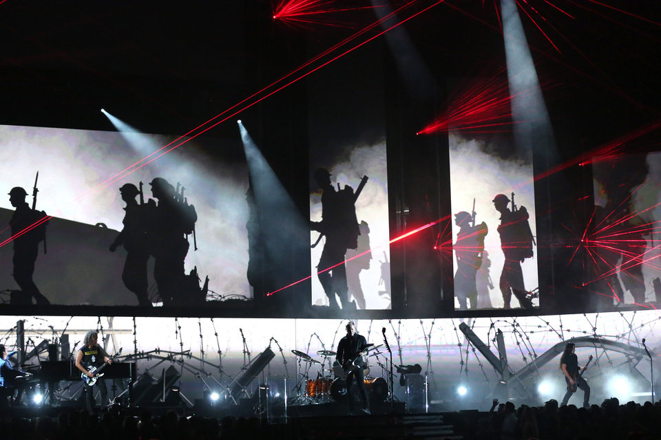 """Photo - Musical group Metallica and Lang Lang, left, perform """"One"""" on stage at the 56th annual Grammy Awards at Staples Center on Sunday, Jan. 26, 2014, in Los Angeles. (Photo by Matt Sayles/Invision/AP)"""