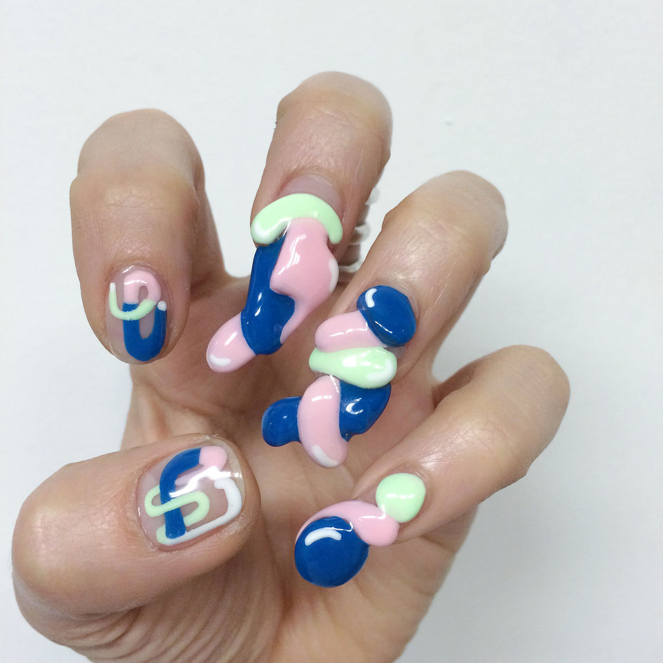 """Photo - This product image released by Nails By Mei shows a  3-D fingernail design by Miho """"Mei"""" Kawajiri. Move over, studded bracelets and chandelier earrings. Right now, it's all about nails. Rhinestones, 3-D designs, textured topcoats and new offerings from fashion royalty have upped the ante on fingertips.  (AP Photo/Nails By Mei)"""