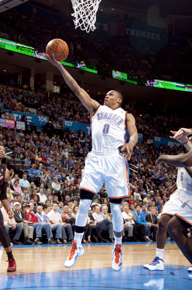 Photo - Oklahoma City's Russell Westbrook (0) shoots a lay up during the NBA basketball game between the Oklahoma City Thunder and the Toronto Raptors at Chesapeake Energy Arena in Oklahoma City, Sunday, April 8, 2012. Photo by Sarah Phipps, The Oklahoman.