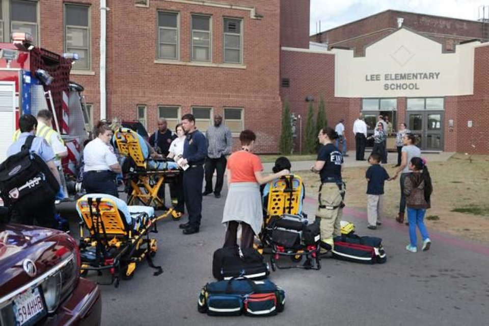 Photo - Students and faculty are evacuated from Lee Elementary School on Monday after a carbon monoxide leak. Photo by David McDaniel, The Oklahoman