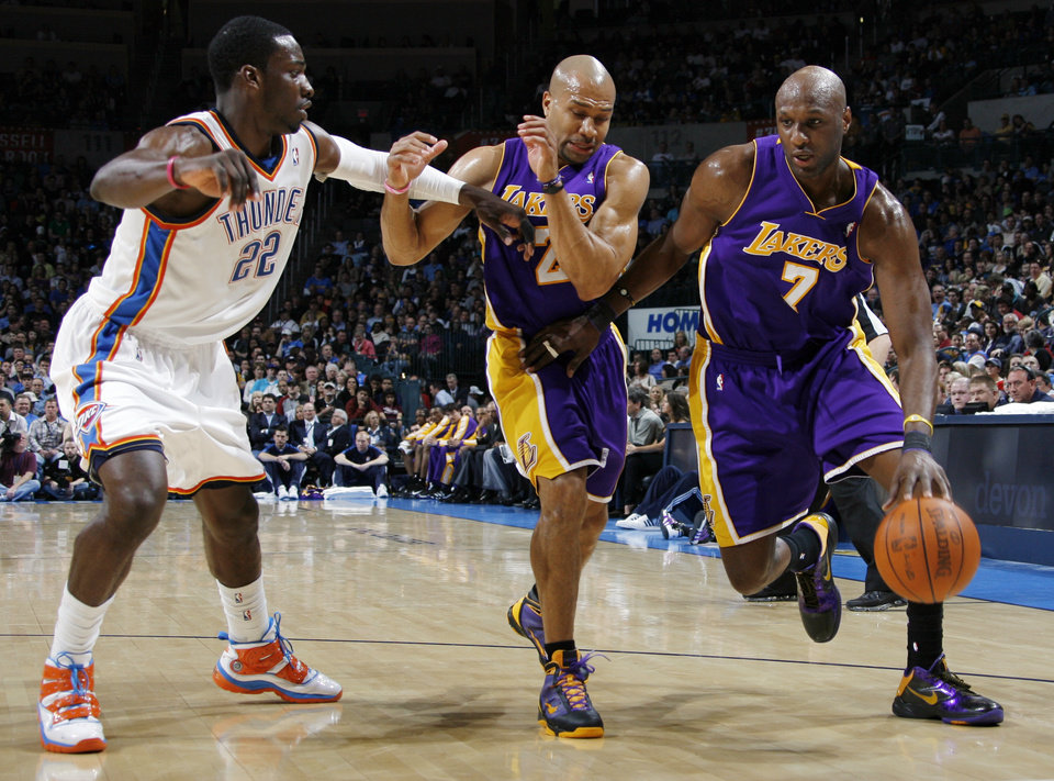 Photo - Lamar Odom (7) of Los Angeles dribbles around teammate Derek Fisher (2) and Jeff Green (22) of Oklahoma City during the NBA basketball game between the Los Angeles Lakers and the Oklahoma City Thunder at the Ford Center in Oklahoma City, Friday, March 26, 2010. Oklahoma City won, 91-75. Photo by Nate Billings, The Oklahoman