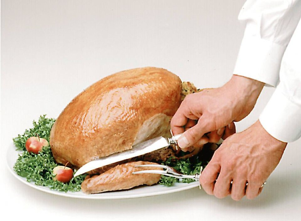 Carving the Thanksgiving turkey: Step 2: Insert fork in upper wing to steady turkey. Make a long horizontal cut above wing joint through to body frame. Wing may be disjoined from body, if desired. BUTTERBALL