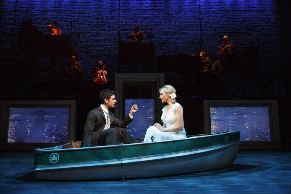 This theater image released by The Hartman group shows Adam Kantor, left, and Betsy Wolfe during a performance of