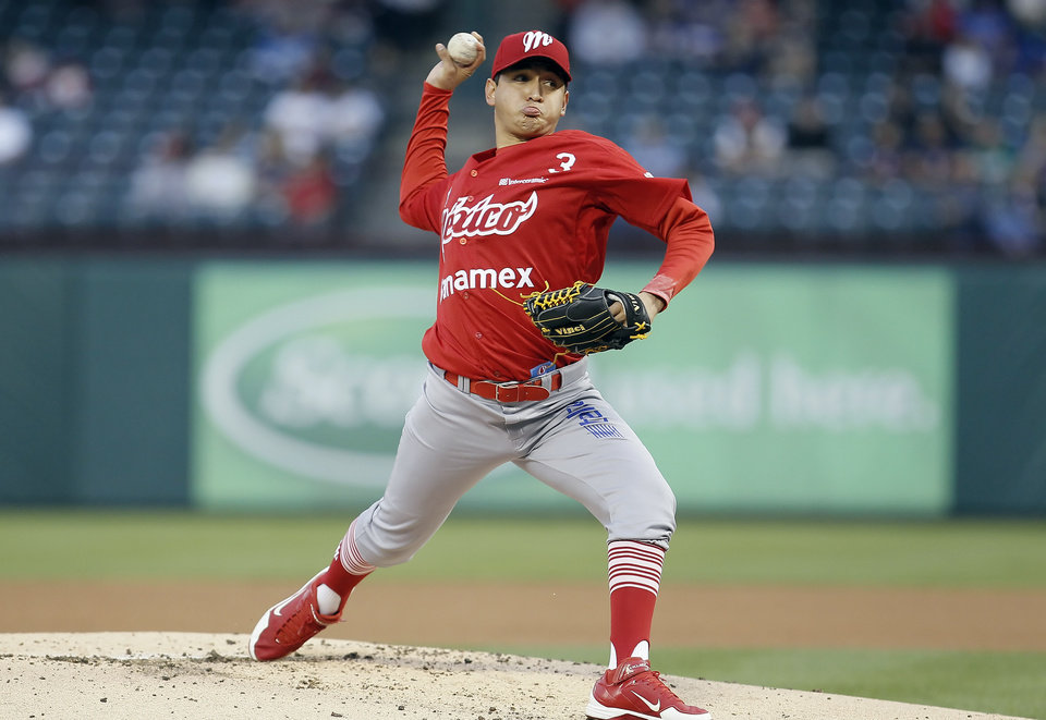 Mexico City Red Devils pitcher David Reyes pitches during the first inning against the Texas Rangers in an exhibition baseball game Thursday, March 28, 2013, in Arlington, Texas. (AP Photo/Fort Worth Star-Telegram, Brandon Wade)