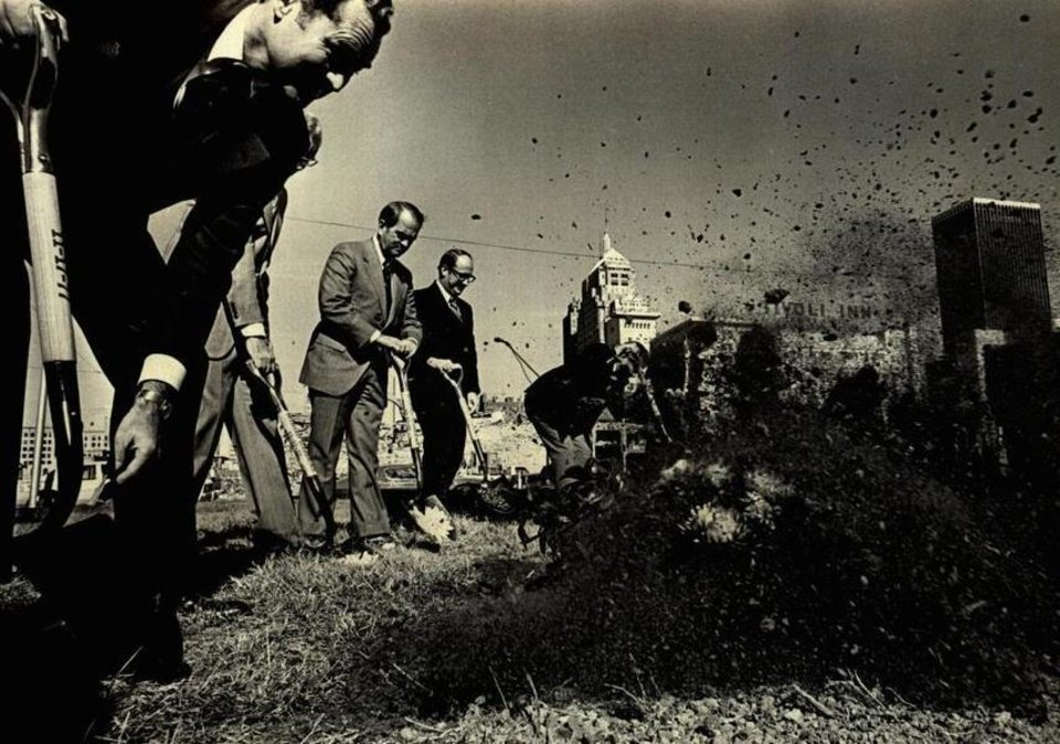 Photo - Shovels were throwing soil during the Myriad Gardens groundbreaking in November 1977 where Ed Cook, left, director of the Myriad Gardens Authority; Richard Harrison, center, president of the Chamber of Commerce; and City Manager Jim Cook joined others in signaling construction of the complex. [Photo by Roger Klock, The Oklahoman Archives]