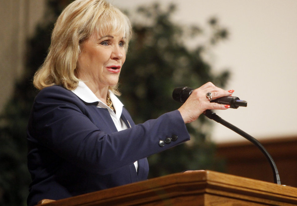 Photo - Oklahoma governor Mary Fallin speaks to officers during the 62nd Oklahoma Highway Patrol graduation at the Memorial Road Church of Christ in Edmond on June 13, 2014. Photo by KT King/The Oklahoman