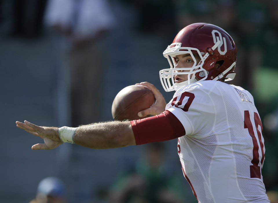 Photo - Oklahoma's Blake Bell (10) throws during the first half of an NCAA college football game against Notre Dame, Saturday, Sept. 28, 2013, in South Bend, Ind. (AP Photo/Darron Cummings)  ORG XMIT: INDC110