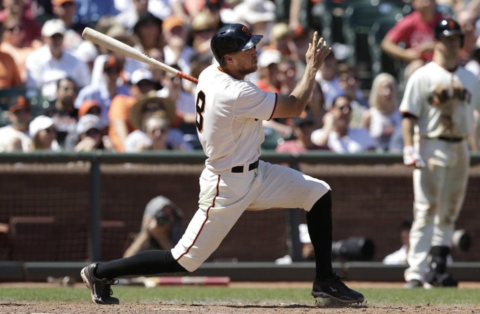 Photo - San Francisco Giants' Hunter Pence doubles to score Gregor Blanco during the fifth inning of a baseball game against the Atlanta Braves in San Francisco, Wednesday, May 14, 2014. (AP Photo)