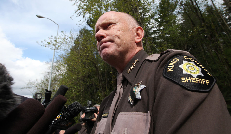 Photo -   King County Sheriff Steve Strachan speaks with media members about police finding the bunker of man suspected of killing his wife and daughter days earlier, Friday, April 27, 2012, in North Bend, Wash. King County deputies say there's someone inside the deep woods bunker of the gun-toting survivalist suspected of the killings and holing up for days in the Cascade foothills east of Seattle. The underground bunker is surrounded by police, who have pumped gas inside. Sgt. Cindi West says photos found in Peter A. Keller's home helped them find the bunker Friday morning. (AP Photo/Elaine Thompson)