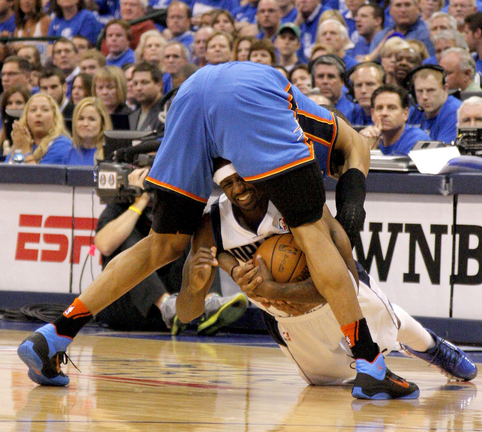Photo - Jason Terry (31) of Dallas goes for the ball under Oklahoma City's Russell Westbrook (0) during game 5 of the Western Conference Finals in the NBA basketball playoffs between the Dallas Mavericks and the Oklahoma City Thunder at American Airlines Center in Dallas, Wednesday, May 25, 2011. Photo by Bryan Terry, The Oklahoman