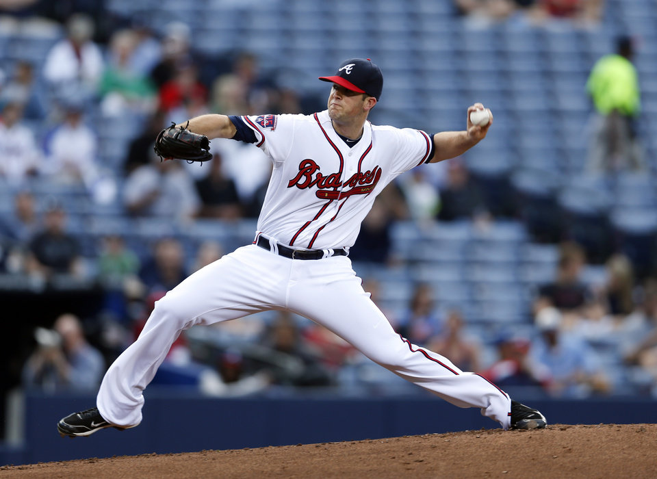 Photo - Atlanta Braves pitcher Alex Wood (40) works in the first inning of a baseball game against the Miami Marlins Tuesday, April 22, 2014 in Atlanta.  (AP Photo/John Bazemore)