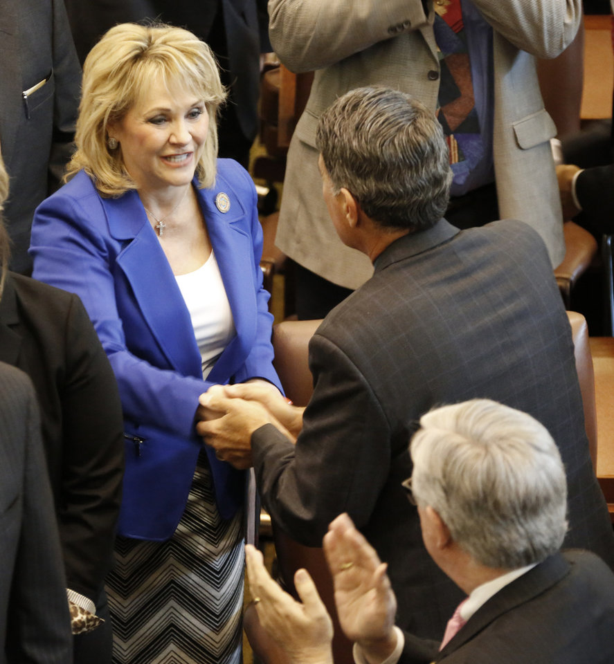 Photo - GOV. MARY FALLIN: Lawmakers greet Governor Mary Fallin  before her State of the State address at the state Capitol in Oklahoma City, Monday February  04, 2013. Photo By Steve Gooch, The Oklahoman