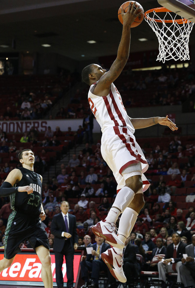 Photo - Oklahoma's Amath M'Baye (22) goes to the basket as Ohio's Ivo Baltic (23) watches during a NCAA college basketball game between the University of Oklahoma (OU) and Ohio at the Lloyd Noble Center in Norman, Saturday, Dec. 29, 2012. Oklahoma won 74-63. Photo by Bryan Terry, The Oklahoman