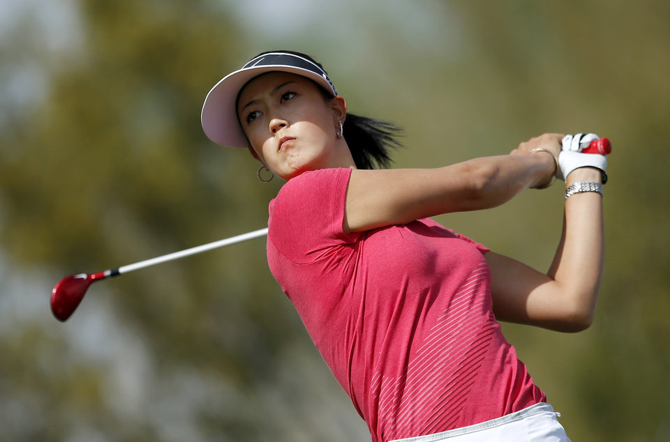 Photo - Michelle Wie hits her tee shot at the 9th hole during the final round of the LPGA Founders Cup golf tournament on Sunday, March 23, 2014, in Phoenix. (AP Photo/Ross D. Franklin)